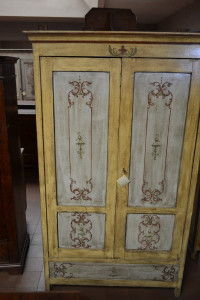 Wardrobe with two doors and a drawer, antique and varnished